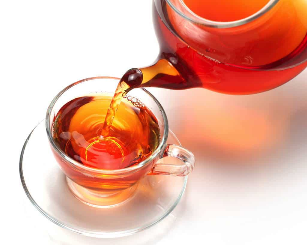 red rooibos poured into a cup